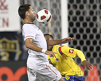 Clint Dempsey #8 of the USA MNT pushes the ball forward past Camilo Zuniga #18 of Colombia during an international friendly match at PPL Park, on October 12 2010 in Chester, PA. The game ended in a 0-0 tie.