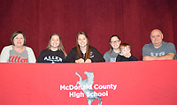 RICK PECK/SPECIAL TO MCDONALD COUNTY PRESS<br /> Kaylee Cornell (center) recently signed a letter of intent to play softball at Allen County Community College in Iola, Kan. From left to right: Mom, (Sheila), sister (Kristen), Kaylee, sister (Kourtney), nephew (Damian) and Dad (Randy).