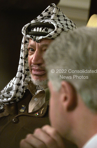 Yasser Arafat, Chairman of the Palestinian Authority,  listens to United States President Bill Clinton in the Oval Office of the White House in Washington, DC. on Thursday, January 20, 2000.  Arafat arrived in Washington on Thursday for a meeting with President Clinton, complaining his peace moves with Israel were going nowhere.               .Credit: Mark Wilson - Pool via CNP