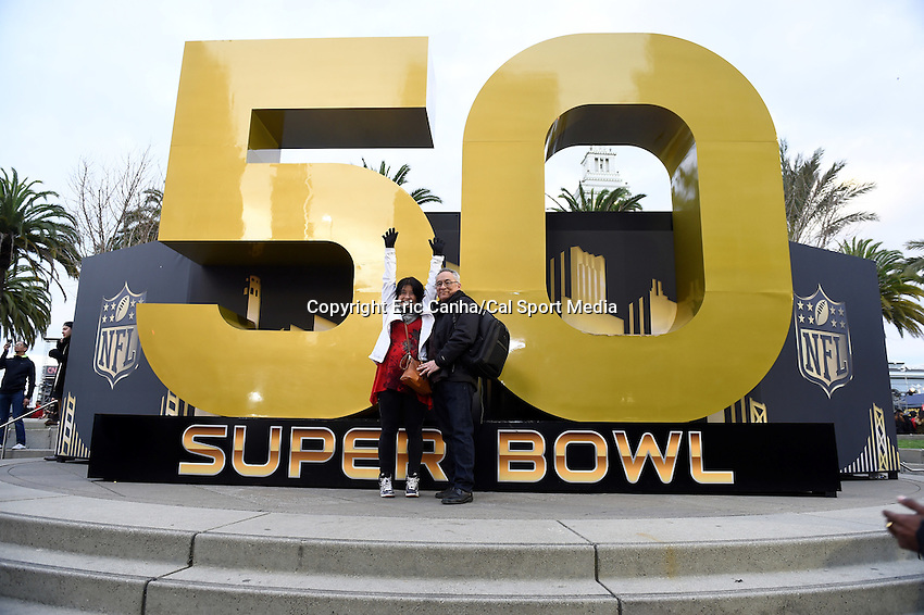 Wednesday, February 3, 2016: Fans pose in front of a large Super Bowl 50 logo in Super Bowl City in San Francisco, California during the National Football League week long opening celebrations for Super Bowl 50 between the Carolina Panthers and the Denver Broncos . Eric Canha/CSM