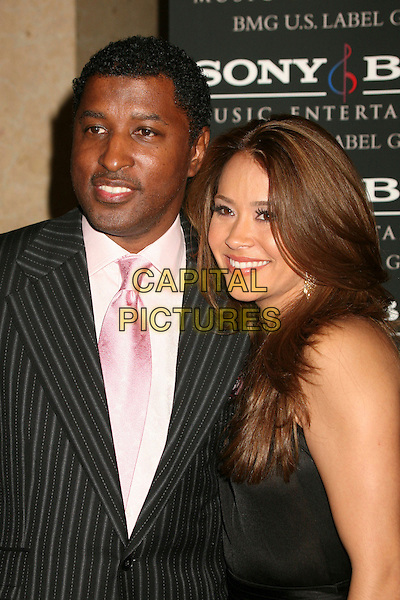 """KENNETH """"BABYFACE"""" EDMONDS & GUEST.Clive Davis 2007 Pre-Grammy Awards Party at the Beverly Hilton Hotel, Beverly Hills, USA..February 10th, 2007.half length black.CAP/ADM/BP.©Byron Purvis/AdMedia/Capital Pictures"""