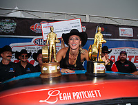 Oct 7, 2018; Ennis, TX, USA; NHRA factory stock driver Leah Pritchett celebrates with crew after winning the Fall Nationals and clinching the 2018 championship at the Texas Motorplex. Mandatory Credit: Mark J. Rebilas-USA TODAY Sports