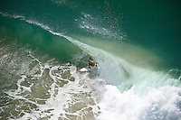 MICK FANNING (AUS)  surfing the Kirra end of the Superbank, Coolangatta, Queensland, Australia, in a swell wiped up by Cyclone Jasper.  Photo: joliphotos.com
