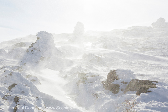 Strong winds blow snow across the summit of Mount Lafayette in the White Mountains, New Hampshire during the winter months.