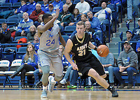 December 12, 2015 - Colorado Springs, Colorado, U.S. -  Army guard, Kyle Wilson #21, drives past Falcon, Dezmond James #24, during an NCAA basketball game between the Army West Point Black Knights and the Air Force Academy Falcons at Clune Arena, U.S. Air Force Academy, Colorado Springs, Colorado.  Army West Point defeats Air Force 90-80.