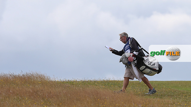 Caddie Julian orienteering during Round Three of the 2015 Aberdeen Asset Management Scottish Open, played at Gullane Golf Club, Gullane, East Lothian, Scotland. /11/07/2015/. Picture: Golffile | David Lloyd<br /> <br /> All photos usage must carry mandatory copyright credit (&copy; Golffile | David Lloyd)