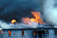Fire in an industrial building, smoke, firefighter,15-3000, 08-3500. Buffalo New York United States.