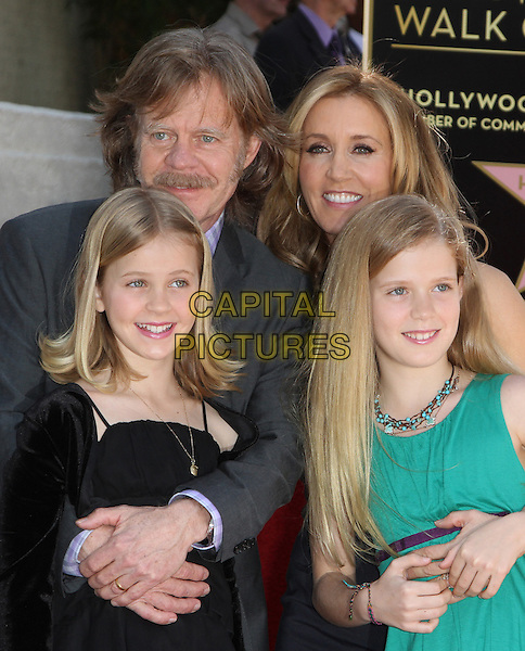 William H. Macy, Felictiy Huffman & Daughters Sophie Grace & Georgia Grace .Felictiy Huffman And William H. Macy Hollywood Walk Of Fame Induction Ceremony Held At On the Walk of Fame, Hollywood, California, USA.  .March 7th, 2012.half length moustache mustache facial hair married husband wife black suit dress suit green family father dad mother mom mum kids children .CAP/ADM/KB.©Kevan Brooks/AdMedia/Capital Pictures.