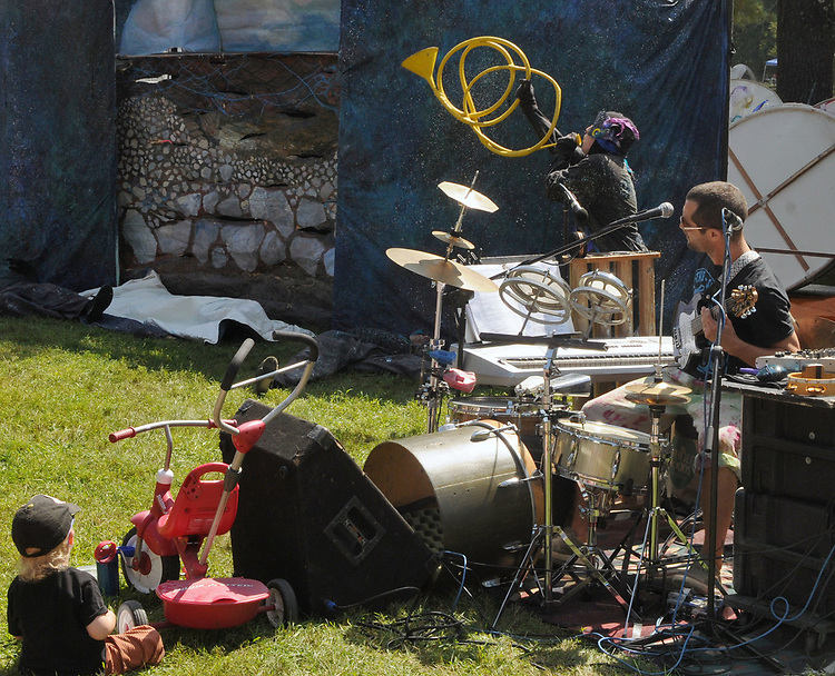 """Narrator, musician and Sound-effects player, Eli Winograd, at work during the ARM-of-the-SEA Theater's performance of """"DIRT: THE SECRET LIFE OF SOIL,"""" at the Fifth Annual SUMMER HOOT Festival, held at the Ashokan Center, Olivebridge, NY, on Sunday, August 27, 2017. Photo by Jim Peppler. Copyright/Jim Peppler-2017."""