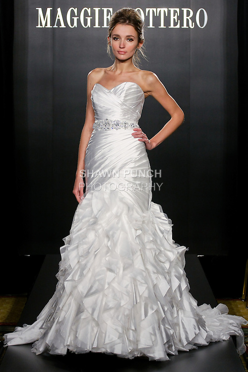 Model walks the runway in a Sloan wedding dress from the Sottero and Midgley Spring 2012 collection, during  Couture: New York Bridal Fashion Week 2012