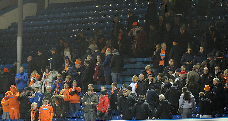 Blackpool fans applaud their side at full time<br /> <br /> Photographer Kevin Barnes/CameraSport<br /> <br /> Football - The Football League Sky Bet Championship - Leeds United v Blackpool - Saturday 8th November 2014 - Elland Road - Leeds<br /> <br /> &copy; CameraSport - 43 Linden Ave. Countesthorpe. Leicester. England. LE8 5PG - Tel: +44 (0) 116 277 4147 - admin@camerasport.com - www.camerasport.com