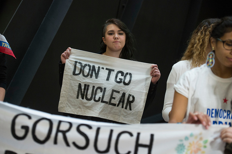 UNITED STATES - APRIL 6: A protester with Democracy Spring demonstrates in Hart Building to oppose the Senate using the nuclear option to confirm Supreme Court Justice nominee Neil Gorsuch, April 6, 2017. (Photo By Tom Williams/CQ Roll Call)