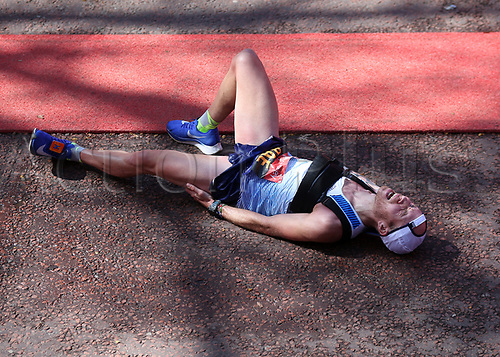 22nd April 2018, London, England; The 2018 Virgin London Marathon; Derek Rae of Great Britain collapse after finishing 1st in the Men's T45/46