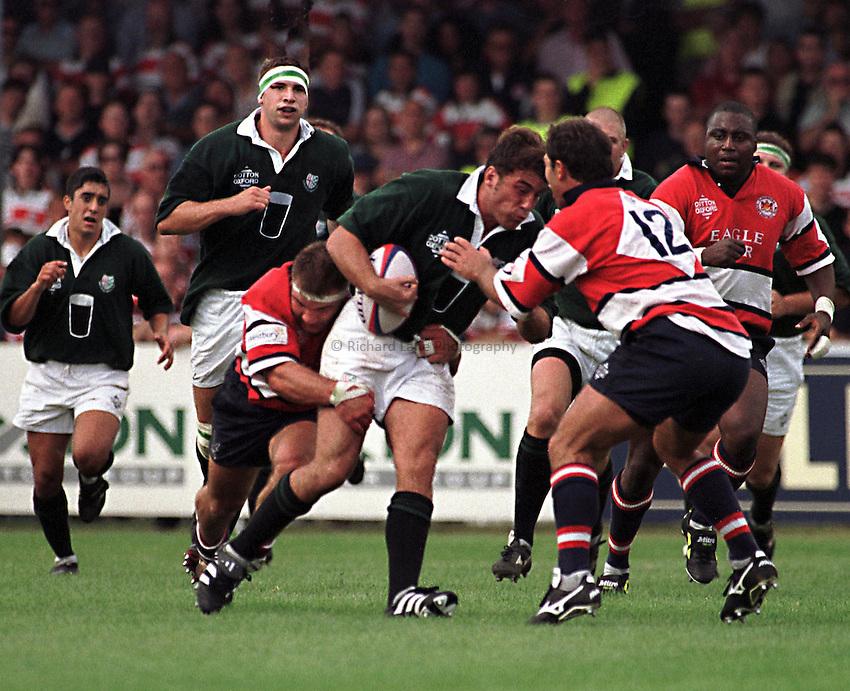 Photo. Richard Lane..Gloucester v London Irish. 5/9/98. Kieron Dawson attacks the Gloucester midfield.