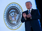 July 23, 2019 - Washington, DC, United States: United States President Donald J. Trump makes remarks at Turning Point USA's Teen Student Action Summit 2019. Trump is standing next to a doctored Presidential Seal on his arrival. <br /> Credit: Chris Kleponis / Pool via CNP