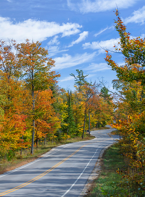 Wisconsin Highway 42 curves and winds it's way through the forest in autumn as it follows the lay of the land as landscape architech Jens Jensen decreed it shouild, Door County, Wisconsin