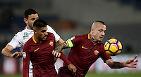 Calcio, Serie A: Roma vs ChievoVerona. Roma, stadio Olimpico, 22 settembre 2016.<br /> Chievo Verona's Ivan Radovanovic, left, fights for the ball against Roma&rsquo;s Emerson Palmieri, center, and Radja Nainggolan, during the Italian Serie A football match between Roma and Chievo Verona, at Rome's Olympic stadium, 22 December 2016.<br /> UPDATE IMAGES PRESS/Isabella Bonotto