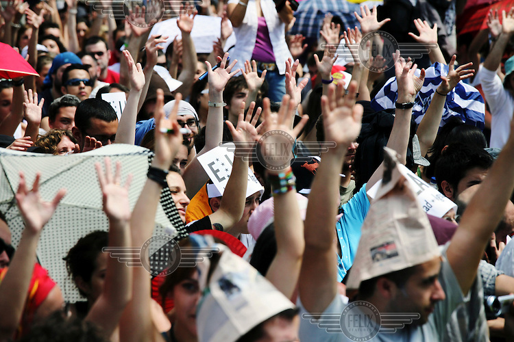 A group of demonstrators raise their hands during a protest against cuts, austerity and joblessness in Madrid's Puerta del Sol square.  In May 2012, following a worsening financial crisis and a deepening recession in Spain, thousands of people started to gather in Spanish cities to protest against austerity, the global financial system, high unemplyment rate (Spain's is the highest rate in Europe) and the lack of opportunities. The protest movement has become known as 'los indignados' (the indignant ones). .
