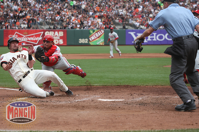 SAN FRANCISCO, CA - AUGUST 7:  Carlos Ruiz of the Philadelphia Phillies tags out San Francisco Giants base runner Aubrey Huff at home plate during the game at AT&T Park on August 7, 2011 in San Francisco, California. Photo by Brad Mangin