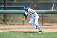 AZL Dodgers third baseman Leonel Valera (23) charges a ground ball during an Arizona League game against the AZL Padres 2 at Camelback Ranch on July 4, 2018 in Glendale, Arizona. The AZL Dodgers defeated the AZL Padres 2 9-8. (Zachary Lucy/Four Seam Images)