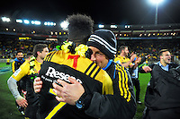 Assistant coach Jason Holland hugs Ardie Savea after the Super Rugby final match between the Hurricanes and Lions at Westpac Stadium, Wellington, New Zealand on Saturday, 6 August 2016. Photo: Dave Lintott / lintottphoto.co.nz
