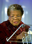 """Washington, D.C. - December 1, 2005 --  Poet and author Maya Angelou reads her poem """"Amazing Peace"""" as part of the festivities to light the 2005 National Christmas Tree in Washington, D.C. on December 1, 2005.   The event marks the opening of the annual Pageant of Peace in the President's Park, also known as the Ellipse. United States President George W. Bush and first lady Laura Bush led the festivities.<br /> Credit: Ron Sachs / CNP"""