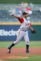 Gwinnett Braves third baseman Hector Olivera (15) warms up between innings of the International League game against the Charlotte Knights at BB&T BallPark on August 24, 2015 in Charlotte, North Carolina.  The Knights defeated the Braves 3-2.  (Brian Westerholt/Four Seam Images)