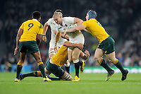 Mike Brown of England is stopped in his tracks by David Pocock and Rob Simmons of Australia as Will Genia of Australia supports during Match 26 of the Rugby World Cup 2015 between England and Australia - 03/10/2015 - Twickenham Stadium, London<br /> Mandatory Credit: Rob Munro/Stewart Communications