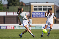 Danielle Sandhu (BINTM9 Finalist) crosses the ball under pressure from Nancy May-Turner (Ex on the Beach) during the 'Greatest Show on Turf' Celebrity Event - Once in a Blue Moon Events at the London Borough of Barking and Dagenham Stadium, London, England on 8 May 2016. Photo by Andy Rowland.