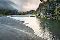 Moody dawn at Smoothwater Bay with Smoothwater River near Jackson Bay, South Westland, West Coast, World Heritage Area, South Island, New Zealand