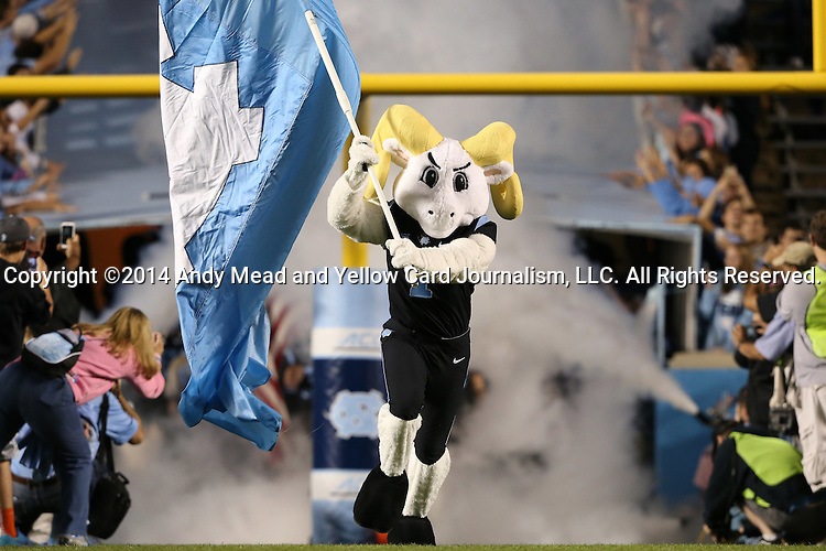 18 October 2014: UNC mascot Rameses leads the team onto the field before the game. The University of North Carolina Tar Heels hosted the Georgia Tech Yellow Jackets at Kenan Memorial Stadium in Chapel Hill, North Carolina in a 2014 NCAA Division I College Football game. UNC won the game 48-43.