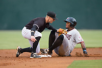 Yanio Perez (28) of the Hickory Crawdads slides into second base ahead of the tag by Max Dutto (6) of the Kannapolis Intimidators at Kannapolis Intimidators Stadium on April 22, 2017 in Kannapolis, North Carolina.  The Intimidators defeated the Crawdads 10-9 in 12 innings.  (Brian Westerholt/Four Seam Images)