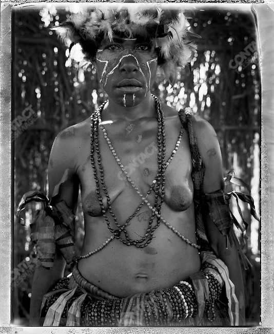 Member of the Kenive village, from the Eastern Highlands Province at the annual 'Sing-Sing' festival, Mount Hagen, Papua New Guinea, August 2004.