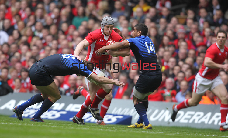 Aurelien Rougerie and Wesley Fofana close the gap on Jonathan Davies..RBS 6 Nations 2012.Wales v France.Millennium Stadium.17.03.12..CREDIT: STEVE POPE-SPORTINGWALES