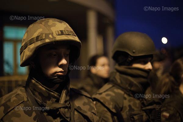 LOMIANKI, 3/2015:<br /> Nocny alarm z replika broni. Czlonkowie organizacji &quot;Strzelec&quot; podczas obozu szkoleniowego w lokalnym gimnazjum. Od rozpoczecia wojny na Ukrainie rozne organizacje paramilitarne staja sie coraz bardziej popularne.<br /> Fot: Piotr Malecki<br /> <br /> LOMIANKI NEAR WARSAW, POLAND, MARCH 2015:<br /> Members of &quot;Strzelec&quot; (&quot;The Shooter&quot;) paramilitary association during night alarm on weekend training at one of the local schools.<br /> Since the start of war in Ukraine, paramilitary associations are becoming more popular.<br /> (Photo by Piotr Malecki)