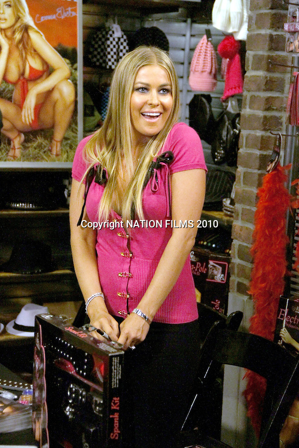 June 18th 2010  Exclusive ..Carmen Electra was at a Sex shop in Santa Monica California today where she was showing off her new line of Sex Toys. Carmen was whipping a guy's butt with a leather Strap and was signing a girls butt with a black marker. Carmen looked very pretty wearing a hot pink shirt with little black bow ties. Carmen posed her cleavage for the cameras as she slapped a shirtless man with a wood & leather Heart sex paddle. ...AbilityFilms@yahoo.com.805-427-3519.www.AbilityFilms.com.