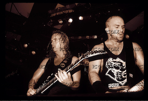 Slayer - guitarists Jeff Hanneman and Kerry King - performing live in a rare club gig at The Whisky-A-Go-Go in Hollywood, CA USA -  August  26, 1996.  Photo credit: Kevin Estrada / IconicPix