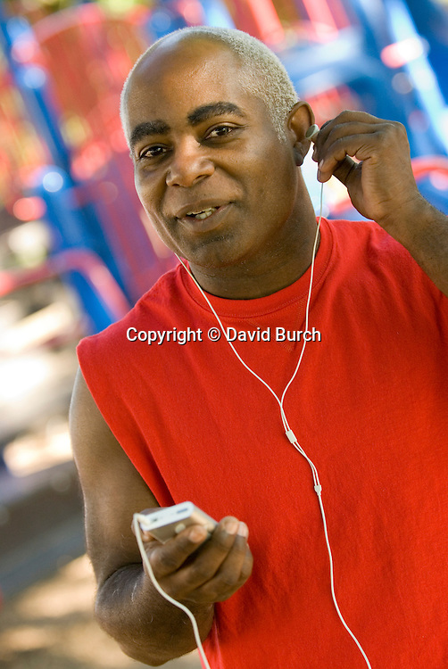 Man listening to music on ipod, portrait