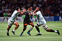 Kiwi Murimurivalu of La Rochelle tries to slip between Leone Nakarawa of Racing 92 (right) and Anthony Tuitavake of Racing 92 (left) during the French Top 14 match between Racing 92 and La Rochelle at U Arena on February 18, 2018 in Nanterre, France. (Photo by Dave Winter/Icon Sport)