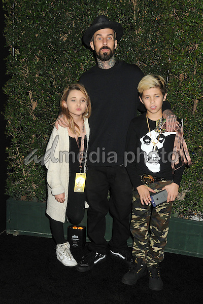 "9 December 2015 - Los Angeles, California - Travis Barker. Opening Night of ""Kurios"" from Cirque du Soleil held at Dodgers Stadium. Photo Credit: Byron Purvis/AdMedia"
