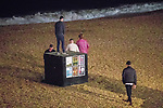 © Joel Goodman - 07973 332324. 26/09/2017. Brighton, UK. A group of men walk out on to the shingles of Brighton beach . Revellers at the end of a night out in Brighton during Freshers week , when university students traditionally enjoy the bars and clubs during their first nights out in a new city . Photo credit : Joel Goodman
