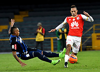 BOGOTA - COLOMBIA - 07 - 05 - 2017: Anderson Plata (Der.) jugador de Independiente Santa Fe, disputa el balón con Jarlan Barrera (Izq.) jugador de Atletico Junior, durante partido de la fecha 16 entre Independiente Santa Fe y Atletico Junior, por la Liga Aguila I-2017, en el estadio Nemesio Camacho El Campin de la ciudad de Bogota. / Anderson Plata (R) player of Independiente Santa Fe struggles for the ball with Jarlan Barrera (L) player of Atletico Junior, during a match of the date 16th between Independiente Santa Fe and Atletico Junior, for the Liga Aguila I -2017 at the Nemesio Camacho El Campin Stadium in Bogota city, Photo: VizzorImage / Luis Ramirez / Staff.
