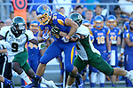 BROOKINGS, SD - SEPTEMBER 6:  Zach Zenner #31 from South Dakota State University is brought down by Nick Dzubnar  #41 from Cal Poly in the first half of their game Saturday evening at Coughlin Alumni Stadium in Brookings.(Photo/Dave Eggen/Inertia)