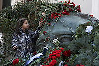 Pictured: A girl leaves a red carnation at the monument for the uprising at the Athens Polytechinc in Athens Greece. Thursday 17 November 2016<br /> Re: 43rd anniversary of the Athens Polytechnic uprising of 1973 which was a massive demonstration of popular rejection of the Greek military junta of 1967–1974. The uprising began on November 14, 1973, escalated to an open anti-junta revolt and ended in bloodshed in the early morning of November 17 after a series of events starting with a tank crashing through the gates of the Polytechnic.