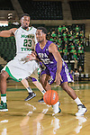 North Texas Mean Green guard Jordan Williams (23) and Stephen F. Austin Lumberjacks guard Desmond Haymon (25) in action during the game between the Stephen F. Austin Lumberjacks and the North Texas Mean Green at the Super Pit arena in Denton, Texas. SFA defeats UNT 87 to 53.