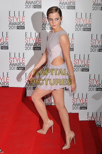 EMMA WATSON.The ELLE Style Awards 2011 at Grand Connaught Rooms, London, England..February 14th, 2011 .full length white grey gray dress sleeveless cut out away side beige nude shoes pointy pointed stairs steps gold cuff bracelet .CAP/PL.©Phil Loftus/Capital Pictures.