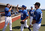 Teammates welcome pitcher Pat McMeel back to the dugout during the alumni game at Western Nevada College in Carson City, Nev., on Saturday, Sept. 7, 2013.  <br /> Photo by Cathleen Allison