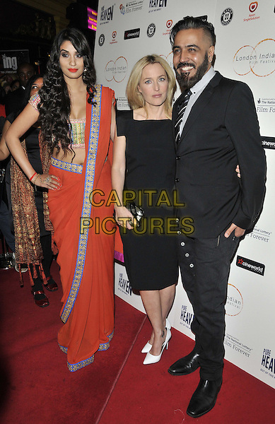 LONDON, ENGLAND - JULY 10: Shay Grewal, Gillian Anderson &amp; Sunny Grewal attend the &quot;Sold&quot; opening film, 2014 London Indian Film Festival, Cineworld Cinema, Haymarket, on Thursday July 10, 2014 in London, England, UK. <br /> CAP/CAN<br /> &copy;Can Nguyen/Capital Pictures