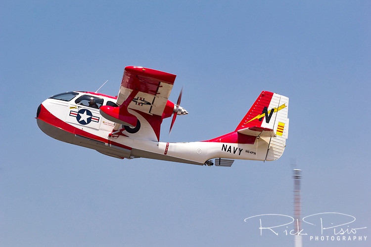 An amphibious Republic RC-3 Seabee (N64PN) in Navy markings takes off from the Nevada County Airport in Grass Valley, California.