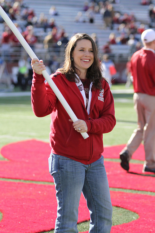 "Kathryn Bramlitt, one of the Washington State University alumni who have waved the Cougar flag on the set of ESPN's College Football ""GameDay"" broadcasts, carries one of the flags out to midfield during a pre-game recognition for all of the Cougar faithful who have treked all over the United States to wave the flag, prior to the Cougars Pac-10 conference contest against the Cal Bears at Martin Stadium in Pullman, Washington, on November 6, 2010."